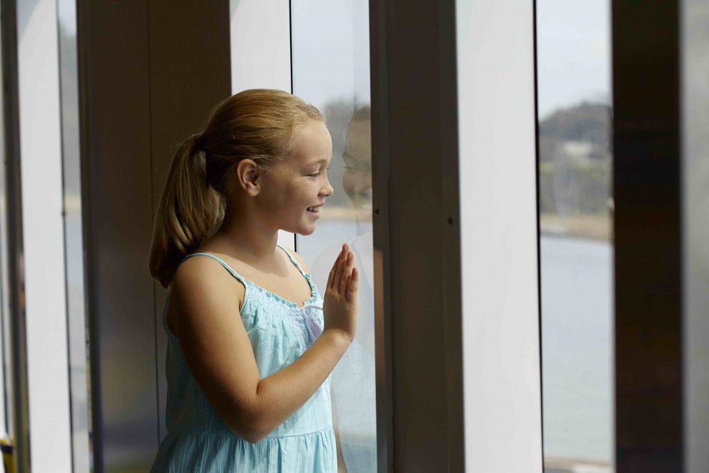 searoad-ferries-girl-looking-out-window